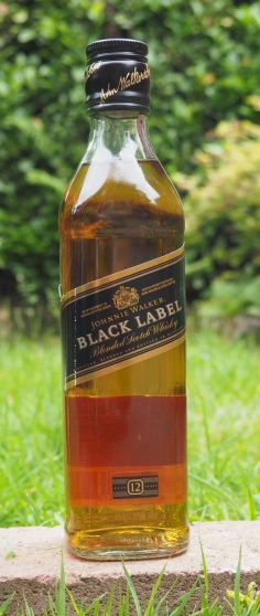 Johnnie Walker Black, on a rock