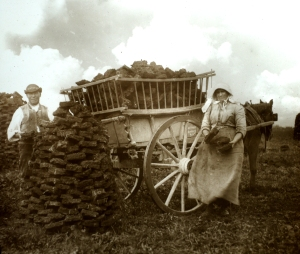 Gathering peat, last century. Not very neat stuff. (Image is public domain)