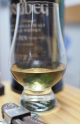 A glass of Ardbeg 10. Yes, it is that light; yes, it has the power (of taste). A testament to the silliness of coloring whisky.
